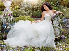 Jim Hjelm 8554 – This gown is a good candidate for a cascading horsehair or organza veil. Super trendy, super pretty. Would you like glass slippers with that?