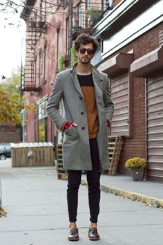 This combination of a grey overcoat and black slim jeans is perfect for a night out or smart-casual occasions. A pair of dark brown leather tassel loafers will bring a strong and masculine feel to any ensemble. Shop this look for $289: http://lookastic.com/men/looks/sunglasses-crew-neck-t-shirt-crew-neck-sweater-overcoat-gloves-skinny-jeans-tassel-loafers/6283 — Dark Brown Sunglasses — Grey Crew-neck T-shirt — Brown Crew-neck Sweater — Grey Overcoat — Red Wool Gloves — Black Skinny ...