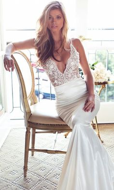 Look at this Lurelly Bridal Glacer gown! We are loving this beaded floral top, fitted silhouette, V line dress. From the skirt flare to the spaghetti strap we can find no flaws! It's made in Los Angeles and is modestly priced at $1,600. Like this look? Share with your friends!  #WeddingDress #gown #share