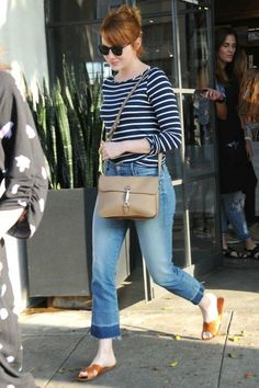 Emma Stone wearing Gucci Jackie Soft Leather Flap Shoulder Bag, Oliver Peoples L.a. Coen Sunglasses, Amour Vert Francoise in Basque Stripe and Mother Undone Hem Tootsie Jeans in Rumor Has It