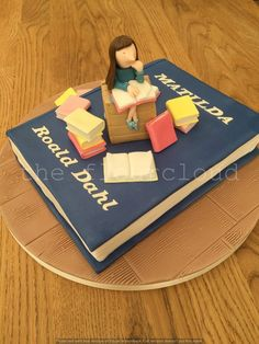 The Roald Dahl character Matilda on this birthday cake.
