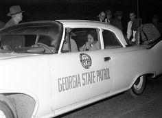 A tearful Charlayne Hunter, 18, is taken away under protective custody from the University of Georgia campus where she had started classes just a few days prior under federal order . Students staged an uprising against the integration