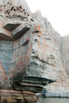 Tim Emmett on the FA of a 7a/25 in the Musandam. Big Wall Bay. Image by Read Macadam