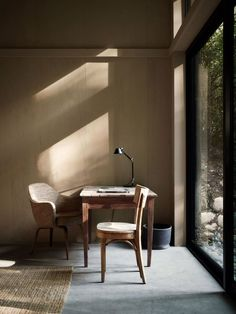 Create a Calm and Tranquil Space in Your Home, small workspace, panoramic windows, minimalistic interior