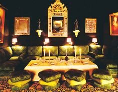 The antiques dealer Alain Demachy's dining room in Paris with green velvet walls, photographed in the 1990s. Marianne Haas
