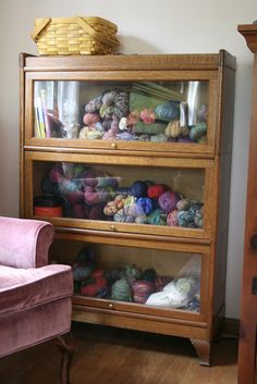 Ooo old Apothecary style storage I have this cabinet at home, it's nice to put my yarn in. awesome cabinet for yarn storage