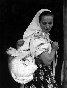 Historical babywearing photo: Slovak woman carrying baby.
