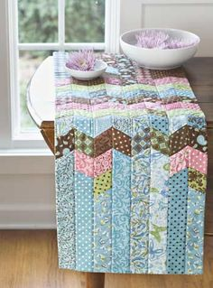 in American Patchwork and Quilting, April 2008 edition Designer Marti Michell,  - jelly roll pattern