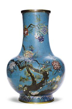 A LARGE PAIR OF CLOISONNÉ ENAMEL 'BIRD AND POMEGRANATE' VASES QING DYNASTY, 19TH CENTURY each with a globular body rising from a spreading foot to a tall waisted neck with an everted rim, brightly decorated with birds and insects amongst flowering and fruiting pomegranate trees issuing from rockwork, all reserved on a turquoise diaper ground, the rim encircled by a keyfret band