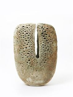 Alan Wallwork (born 1931) a large stoneware split form vase, incised, and glazed in ochre and whi