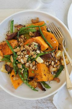 "Garlic Roasted Pumpkin Salad - ""Sweet pumpkin and cream cheese roasted in garlic with crunchy, savoury bacon, nuts and juicy greens. You'll never have leftovers with this luscious winter salad!"" - ozpanda"