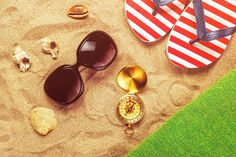 Beach ready, summer holiday vacation accessories on sandy beach by Igor Stevanovic on 500px