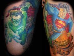 green lantern and superman arm tattoo