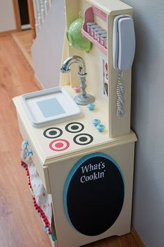 Little Gray Table: Play Kitchen Reveal - fun accessories!  Like the spice rack and old school phone!