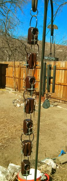 Small rain chain. Made from old insulators and by TheCrimsonDynamo, $20.00