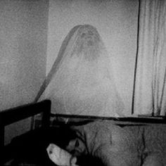 Disturbing Picture Of A Ghost Hovering Over Sleeping Woman