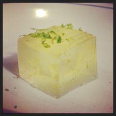 Caipirinha jello shot with lime zest garnish