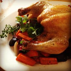 Chicken Roasted with carrots, beets, onions, thyme, & parsley