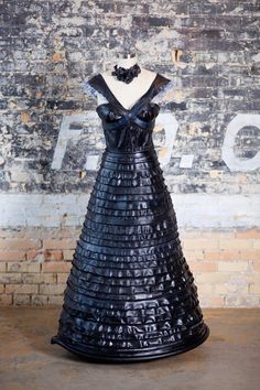 Bicycle inner tube dress with shoulder ruffles made of plastic water bottles. By Willi Nilli.