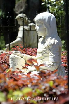 Savannah, April 26, 2014 - Bonaventure Cemetery - Gracie Watson, died of pneumonia at age six, at Easter time. Her father was devastated and had this sculpture created by artist John Walz (many of his creations are in Bonaventure) from a photo of the little girl.   by Mary Homick