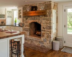 Kitchen Showcasing Cozy Fireplace-07-1 Kindesign
