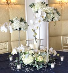 Gorgeously designed wedding arrangement.  Flowers consisting white hydrangeas, white cabbage, white roses, seeded eucalyptus,  phalaenopsis orchids, and dusty Miller.