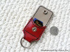 100% hand stitched handmade red cowhide leather keychain / SD card / guitar pick / golf ball marker holder with a free Fender Celluloid pick by leathercraftbygrace on Etsy https://www.etsy.com/listing/102038485/100-hand-stitched-handmade-red-cowhide