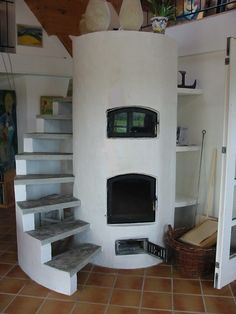 Masseovnen - a round mass stove with built staircase