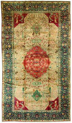 An early 20th century antique Persian Tabriz hunting carpet, with a classical central medallion with dancing angels, birds and ducks on a beige field with a garden pattern within a dark blue palmette vinery border. Watch full size video of A Persian Tabriz carpet, Circa 1900, ID BB0642 - Video