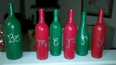Wine bottles painted with acrylic paint and sprayed with glass.