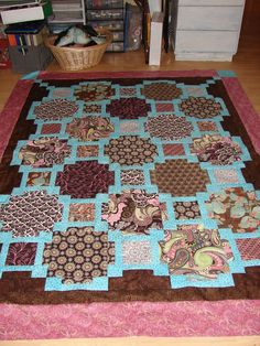 Another quilt with small squares framing large squares. Great for ... : quilt patterns for big prints - Adamdwight.com