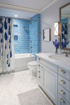 Blue subway tile. Bathroom with blue subway tile wall and hex marble floor tile. Blue subway tile #Bluesubwaytile Martha O'Hara Interiors