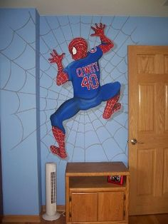 Spiderman Cubs Mural - Spiderman clings to the wall in this hand painted kids mural.