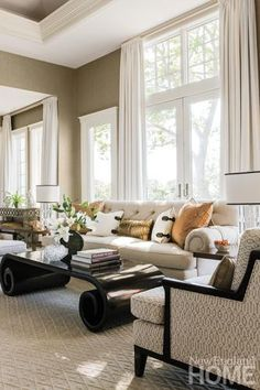 Accent pillows covered in Fortuny fabric add a dash of color to a neutral living room. - Interior design: Starr Daniels, SD Home,  Architecture: John Margolis