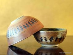 """Set of 2 bowls are from """"Earthifacts"""" Warli series. Warlis are adhivaasis living in the maharashtra-gujarat border areas. their rudimentary sketches or paintings use a very basic vocabulary – circle, square and triangle. Check out http://www.worldartcommunity.com/items/warli-bowls/"""