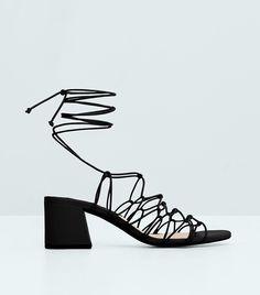#TuesdayShoesday: 7 Stylish Black Sandals Under $100 via @WhoWhatWear