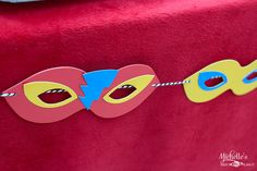 Super Hero Party - Mask garland made with Bakers Twine   from Pick Your Plum #pyp #bakerstwine
