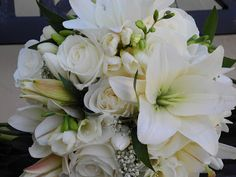 The New Fuss About Bridal Bouquets Bouquets are found in a lot of shapes and styles. Bridal bouquets have existed for quite a long moment. The bridal bouquets are among the prettiest areas of a wedding. Lilly Bouquet Wedding, White Wedding Bouquets, Bridesmaid Flowers, Bridal Bouquets, Lily Wedding, Comic Book Wedding, White Floral Arrangements, Montana Wedding, Bridal Shower Tea