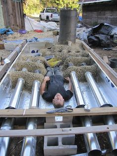 Rocket Stove mass heater used for heated floor to go under Yurt! Sweet set up!