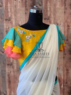 Available Stylish multi colour ruffled Pallu on a Half white Georgette saree teamed with a yellow hand work blouse from Team…Teja sarees hyderabad contact 8790382382 email tejasarees comSold For those who love the brighter shades . Simple Blouse Designs, Saree Blouse Neck Designs, Stylish Blouse Design, Bridal Blouse Designs, Pattern Blouses For Sarees, Brocade Blouse Designs, Saree Blouse Patterns, Sleeves Designs For Dresses, Outfit Invierno