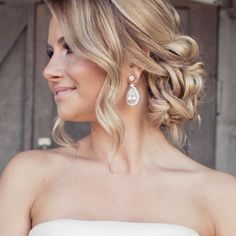 Wedding Updos That Are Beautiful From Every Angle #refinery29 http://www.refinery29.com/bridal-guide/26#slide-17 If you're comfortable having some of your hair falling loose and soft, this one's a beauty....
