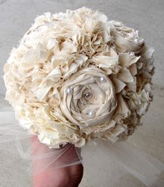 Liking the fabric/fake flower bouquets. Cheaper and eco-friendly. I lack the mad skills to DIY this so thank god for etsy.