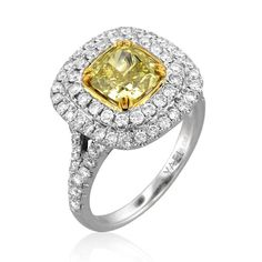 Amun ring with a fancy yellow diamond accented with white diamonds by YAEL DESIGNS