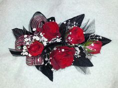 Red black and white corsage