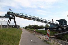 Zandoverslag lopende band Almere Poort