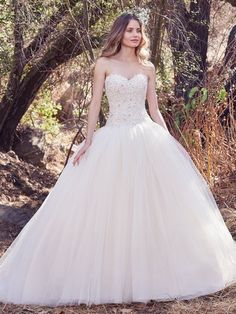 Maggie Sottero - libby, This princess wedding dress features a strapless bodice of beaded lace appliqués and Swarovski crystal embellishments. A soft sweetheart neckline and a voluminous tulle ballgown skirt evoke fairytale romance. Finished with covered buttons over zipper and inner corset closure.