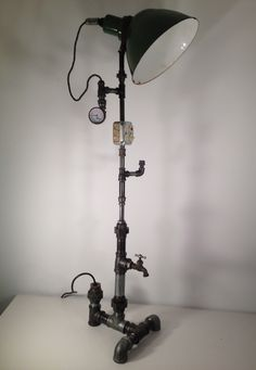 """- Little over 4 feet tall - wired 14/2 w/ ground - Green enamel Shade, rotates up and down - 45+ pieces of 1 1/2"""" to 1/2"""" black malleable iron #steampunk #floorlamp"""