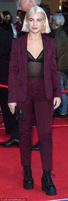 f3631bc6b17 Chris Evans appears to peep at Elizabeth Olsen s cleavage at premiere