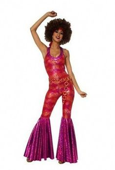 ecfe12929c 70 s Foxy Lady costume comes with a groovy metallic jumpsuit with gold tone  belt. We