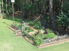 pickets extend out entrance arbor & no plantings outside fence...